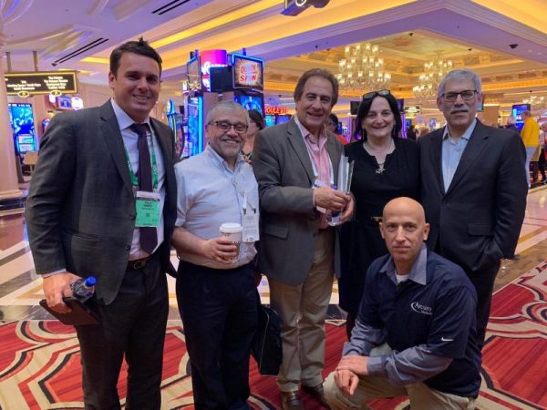 Arcuro Medical team members and orthopedic surgeons from Chile at the American Academy of Orthopaedic Surgeons (AAOS) 2019 Annual Meeting, Las Vegas, Nevada, 12-16 March. Pictured: (left) Arcuro Marketing & Bus. Development Consultant Peter Hamann, (2nd from right) CEO Lee Ranon, (right) Trendlines Chairman & CEO Todd Dollinger; (front) Arcuro Design Engineer Eran Zakai.