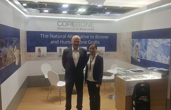 CoreBone CEO Ohad Schwartz and a dentist from Singapore in the CoreBone booth, International Dental Show (IDS), Cologne, Germany, 3-6 March.